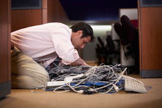 Businessman with Tangled Cables --- Image by © Tim Pannell/Corbis